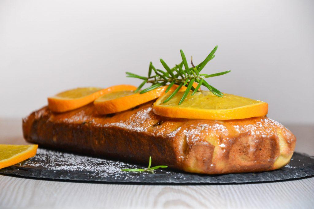 Lemon loaf with orange glaze and orange slices